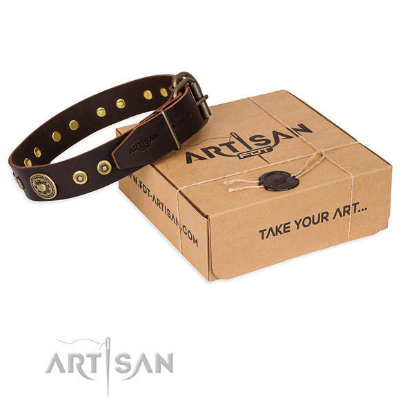 Genuine leather dog collar made of quality material with rust-proof hardware